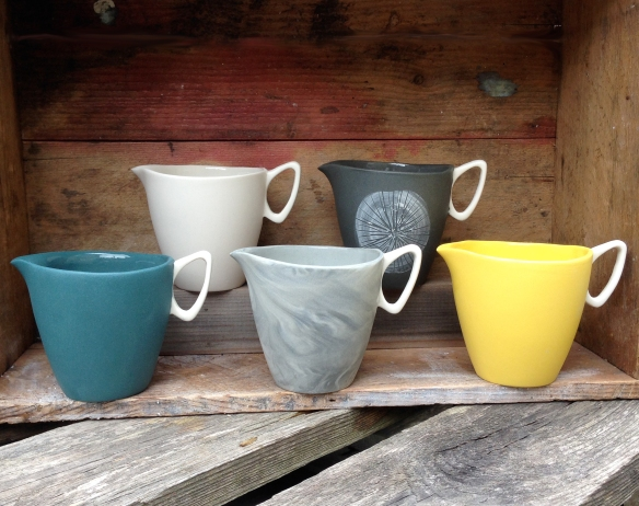 five slip cast jugs